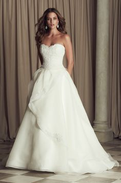 French Alençon Lace and Organdy bridal gown. Strapless sweetheart drop waist lace bodice. Full organdy skirt with cascading mohair detailed edging with lace appliqués scattered. Chapel Train. Style 4463. #PalomaBlanca #PalomaGown Paloma Blanca Wedding Gown