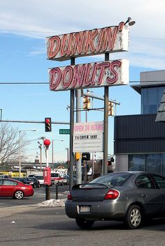 Dunkin' Donuts sign. f Market St. and North Beacon St. in Brighton, MA. - Back in the day when we took our coffee staight up with donuts.