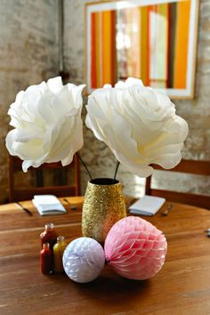 How to make oversized paper flowers on http://therewm.com/2014/05/14/make-diy-oversized-paper-flowers/