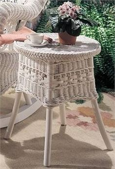 Victorian Wicker Accent Table  A natural wicker table with antique style detailing. The Victorian Wicker Accent Table makes a great accessory to the Victorian Wicker Rocker. Measures: 19