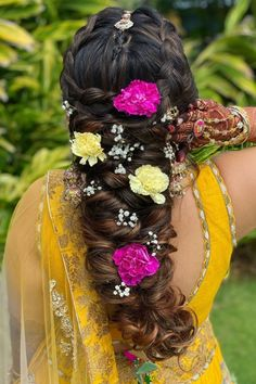 Mermaid Braid tucked with Yellow and Pink Carnations with a few baby's breath styled on a yellow lehenga perfect for sangeet or haldi ceremony.    #Indianweddings #shaadisaga #indianbridalhairstyles #hairstyleswithflowers #intimatewedding #realflowers #uniquecolourlehenga #babybreaths #lowbun  #exoticflowerhairstyle #carnations #mermaidbraid Mehndi Hairstyles, Indian Bridal Hairstyles, Indian Groom, South Indian Bride, Yellow Carnations, Mermaid Braid, Haldi Ceremony, Wedding Moments, Real Flowers