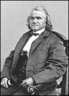 "Stand Watie (December 12, 1806 – September 9, 1871; also known as Standhope Uwatie, Degataga (Cherokee: ᏕᎦᏔᎦ), meaning ""stand firm"", and Isaac S. Watie) was a leader of the Cherokee Nation and a brigadier general of the Confederate States Army during the American Civil War. He commanded the Confederate Indian cavalry of the Army of the Trans-Mississippi, made up mostly of Cherokee, Muskogee and Seminole, and was the final Confederate general in the field to surrender at war's end."