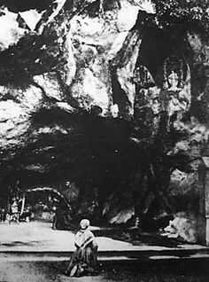 Saint Bernadette Soubirous in the grotto of Lourdes (1863) three years after the first vision