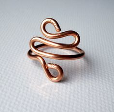 Ring Wire wrap waves S Copper Adjustable. $8.00, via Etsy.