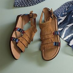 Fringed-Suede Sandals  £58  Authentic Native American-style sandals from the Minnetonka Moccasin Co., established in 1946. Suede with woven fabric panels; metal buckle fastening.