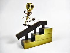 Skateboarding figurine performing backside 5-0. Skate art. Skateboard. Bronze art. Gift ideas by Paraschis on Etsy