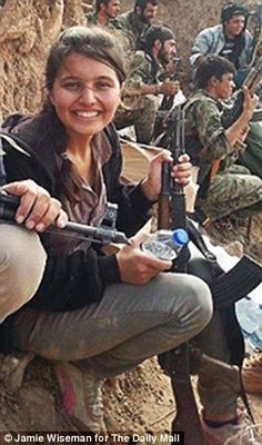 Courage: Fighter Nesrin Abdi pictured with her comrades on the battlefield in Kobane after reclaiming a strategic hill from ISIS. Jihadis believe if they are killed by a woman, they will NOT go to heaven, which makes the dedication of Nesrin and women warriors like her even more AWESOME!!