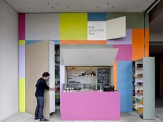 This tea store in Brazil brings a whole new meaning to the term 'pop-up shop' - because it literally folds out of an alleyway wall, pop-up book style.