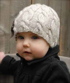 Ella cable hat knitting pattern for children. Find this adorable pattern for Winter and more baby knitting inspiration at LoveKnitting.Com.