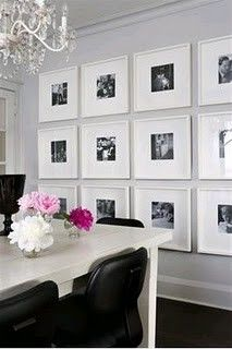 wall of large frames and black and white pictures