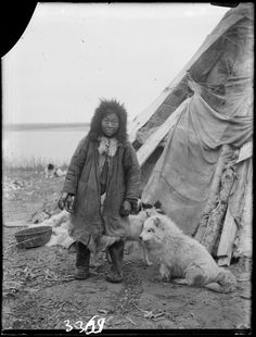 Woman with a dog at the traditional house. Yenisey region, Russia. Early XX century