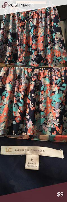 Lauren Conrad Fun Floral Skirt Floral skirt size medium. Short skirt with zipper on back. Lauren Conrad. Beautiful colors. Smoke free home. No stains or tears. Lauren Conrad Skirts Mini