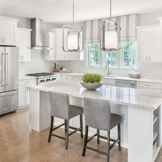 This bright, white kitchen is inspiring our inner chef! What would you cook up in this stylish space?