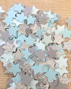 Use this twinkle twinkle little star baby blue, blue, gray and silver glitter confetti to decorate tables, stuff invitations, and more! Perfect