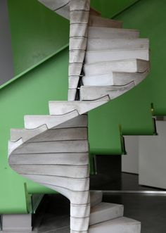 Helix Staircase by Matter Design - each concrete tread modual is slotted into the next below tightly forming a rigid supported spiral stair structure
