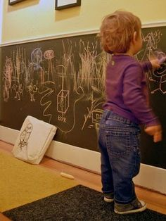 Chalkboard wainscoting like this but with more colorful chalkboard paint.