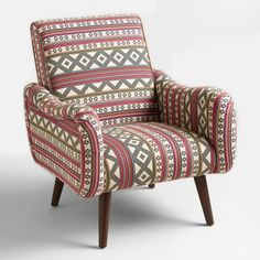 Bring boho style to your living space affordably with our petite chair boasting a deep seat, splayed mid-century-inspired legs and bean-shaped arms. This retro piece is covered in jacquard woven fabric featuring our exclusive, eclectic multicolor print on a cream ground.