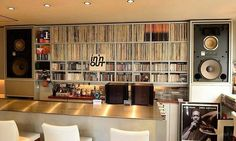 Vintage audio Hi-Fi Era JBL speakers and a nice vinyl record collection. Talk about your wall of sound!