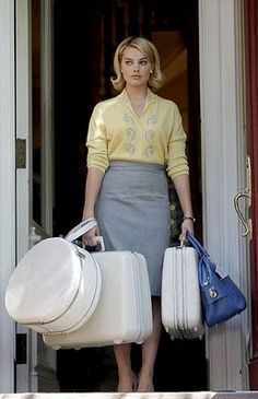 Margot Robbie as Laura Cameron on Pan Am.  Love the vintage luggage!