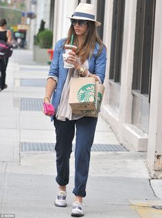 City style: actress Jessica was off-duty in a boyish blazer, baggy chinos and flat lace up shoes
