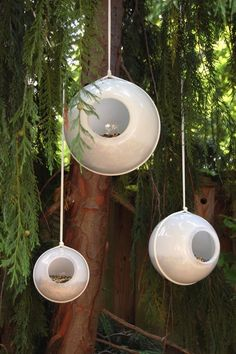 Outdoor glass light orb cover repurposed into hanging bird feeders