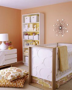 "Bring modern style to a nursery with geometric motifs and clean-lined furniture. Keep the look kid-friendly by using soft colors. Love this room!  Check out the bookcase that is used for storing all that needed baby items without looking cluttered. Plus room will be easy to ""upgrade"" as baby gets older."
