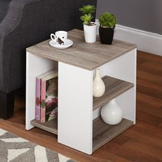 The reclaimed look finish adds a touch of sophistication to this stylish side table. With three shelves to keep everything organized and your space clutter free, this end table offers functionality as