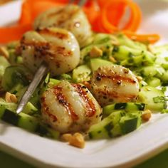 Chili-Crusted Scallops with Cucumber Salad. The Best Healthy Seafood Recipes.--- A refreshing salad of cucumbers and roasted cashews makes a nice contrast to these smoky scallops. You can make the salad and scallop skewers up to 8 hours in advance; cover separately and store in the refrigerator until you're ready to grill.