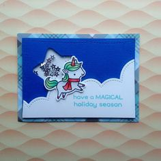 "A magical Christmas shaker card, using the ""Winter Unicorn"" stamp from ""Lawn Fawn""."