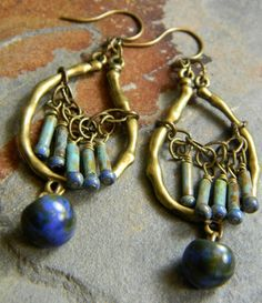 ***On the Fringe***      Delicate Czech glass tube beads are dangled from antique brass chain to form a delicate fringe on my one-of-a-kind bohemian earring design. Mushroom shaped Czech glass in deep blue with a mottled green Picasso finish hang from the bottom of these 2.25 inch long earrings.
