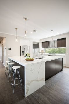 Nice wonderful waterfall calacatta countertops for a clean and modern kitchen space