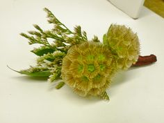 Small seedhead boutonniere created for a two year old and constructed with magnets! No Pins!