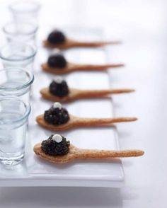 Peter Callahan's edible cracker spoons with caviar and creme freche ~ oh! and a shot of ice cold vodka, of course {Photo: Con Poulos}