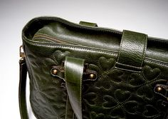 Close up: Green vegetable tanned quilted leather with heart shapes by Romana Correale. Luxury handmade in Tuscany, Italy.   $1289 #fashion #bag #leatherbag #design #beauty #madeinitaly #luxury #handbag #purse #madeintuscany #handmade #romanacorreale #leather #green #vegetabletanned #quilted #heart