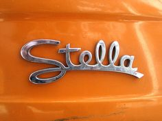 Metal logos, lettering, emblems, and badges affixed to vintage autos and appliances