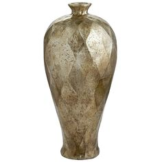 The spectacular Diamond Cut Vase reminds us of you—multifaceted, statuesque, radiant, handcrafted, bold, good-looking in an entryway, etc. The analogy gets a little shaky at hand-silvered ceramic, but you can't have everything.