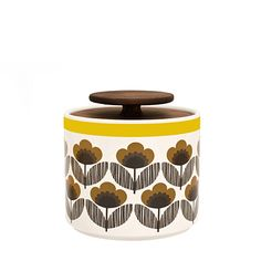 Orla Kiely: This ceramic storage jar with Poppy Meadow print will compliment any stylish kitchen, whether retro or contemporary. Lid is made of 'freijo' wood.    These ceramics are produced in Portugal and are handmade. Pieces may therefore display slightly varied characteristics.    PLEASE NOTE:  Ceramics are sold within the US only.    Weight: 1.65 lbs  Volume: 33.81 fl oz