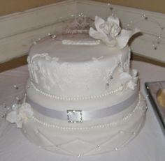 Daughter's wedding cake, first attempt at hand iced lacework to match her dress and quilting