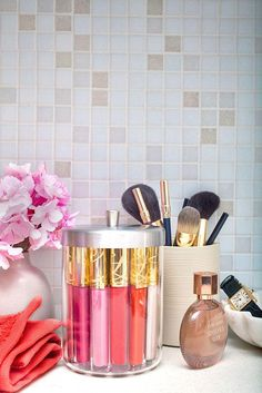 Beauty Product Organization: 10 Chic Ways to Decorate Your Vanity -makeup brushes and lip glosses + stains in cute jars + vases