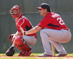 manager Mike Matheny (right) gives instruction to catcher Carson Kelly during St. Louis Cardinals spring training 2015