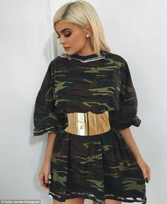 Trend setter! Kylie Jenner took to Instagram on Wednesday as she wore a camouflage shirt as a dress, cinched in with a thick gold belt