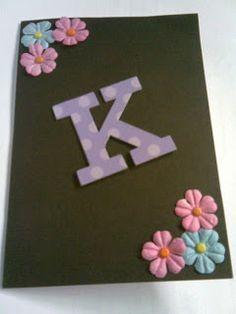 Birthday card K flowers purple black