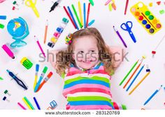 Child with draw and paint supplies. Kids happy to go back to school. Preschool kid learning and studying. Creative children at kindergarten. Office supply objects collection. - stock photo