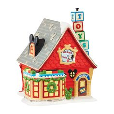 "Mickeys Village Series Dimensions: 5.25""W x 5.5""D x 6.125""H Department 56#: 4047184 Lighted Building Materials: UL Cord, Earthenware Coordinates With: 4049831 - Mickeys Toys Electrical:  Standard cord and bulbReplacement Bulb:  56.99244Replacement Cord:  56.99028"