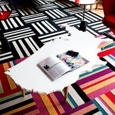 Would love to DIY with this table. It's the shape of continents cut out, painted white, and with legs...
