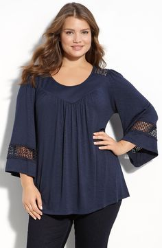 Free shipping and returns on Pleione Crochet Trim Top (Plus Size) at Nordstrom.com. A panel of open crochet work trims the bell sleeves and back yoke of a drapey top in a soft, silky knit.