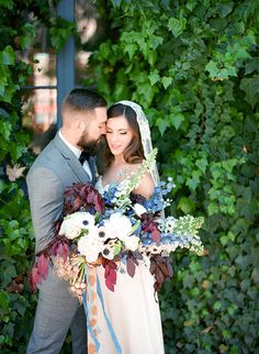 Romantic Wedding Portraits with a Dramatic Bouquet | Samantha Kirk Photography | Blue, Burgundy, and Bronze Spring Wedding