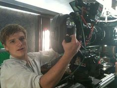 Old photo of Josh on set of The Hunger Games...maybe one day he'll direct!