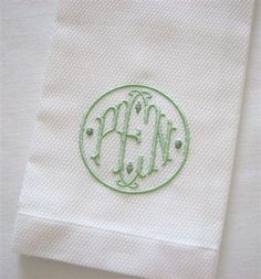 """white pique guest towel with """"David"""" monogram in celadon."""