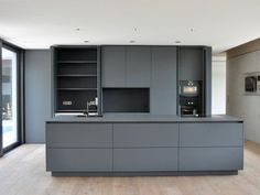 kitchen program by heronlab made of fenixntm black ingo and stainless steel worktop. Black Bedroom Furniture Sets. Home Design Ideas